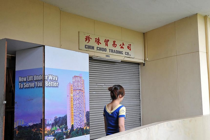 Mr Yap Chui Kee, 76, lives in Pearl Bank with his wife, Madam Too Poh Eng. Madam Too said they would never sell the three-bedroom unit, which they bought in 1993. The building needs sprucing up. Chin Choo Trading (top) on the ground floor has been sh