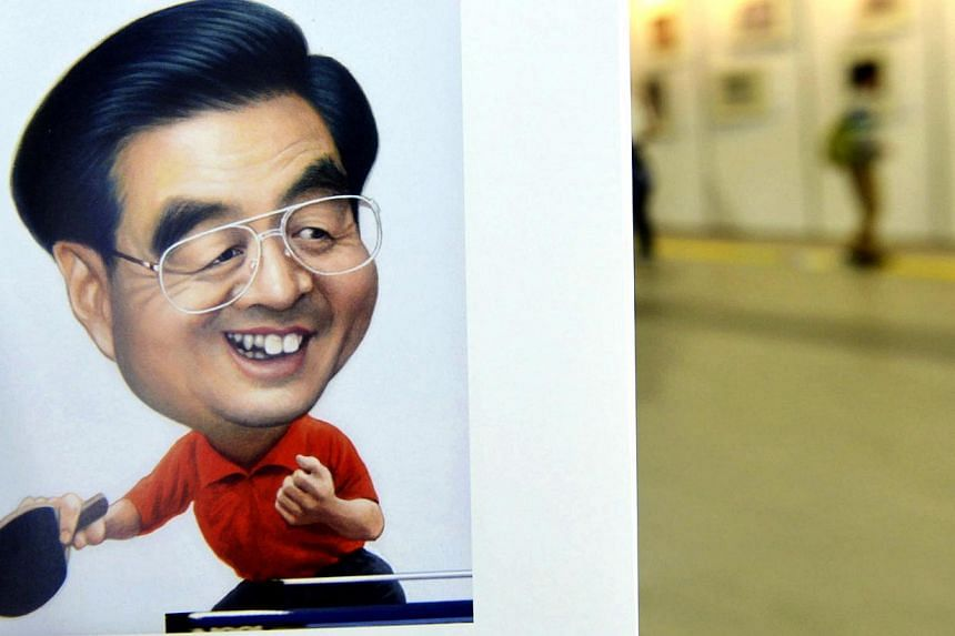 A portrait done by cartoonist Zhu Zizun of China's former President Hu Jintao, is seen during China International Cartoon and Animation Festival in Hangzhou, Zhejiang province, April 29, 2014. -- PHOTO: REUTERS