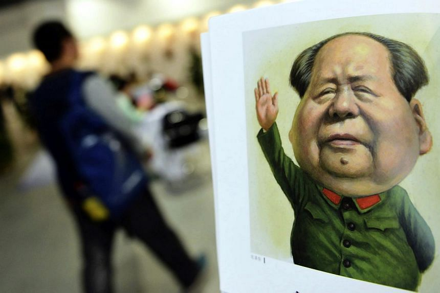 A portrait done by cartoonist Zhu Zizun of China's late leader Mao Zedong is seen during China International Cartoon and Animation Festival in Hangzhou, Zhejiang province, April 29, 2014.-- PHOTO: REUTERS