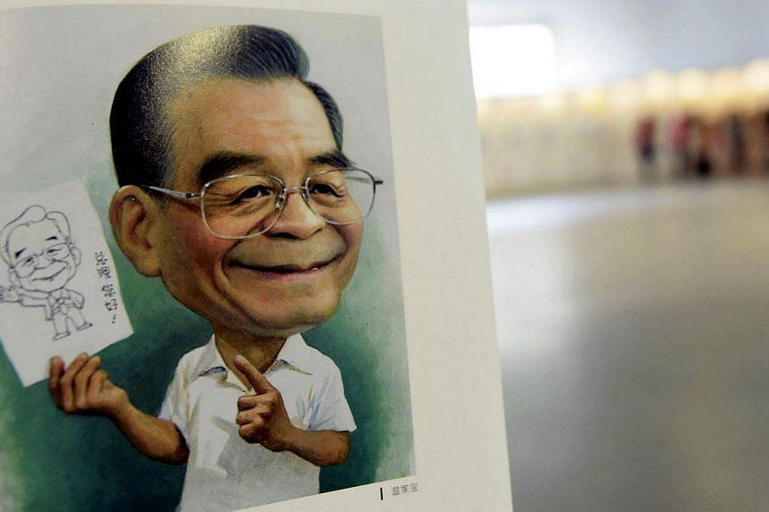 A portrait done by cartoonist Zhu Zizun of China's former Premier Wen Jiabao, is seen during China International Cartoon & Animation Festival in Hangzhou, Zhejiang province, April 29, 2014.-- PHOTO: REUTERS