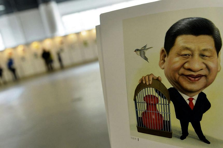 A portrait done by cartoonist Zhu Zizun of China's President Xi Jinping, is seen during China International Cartoon & Animation Festival in Hangzhou, Zhejiang province, April 29, 2014. Picture taken April 29, 2014. -- PHOTO: REUTERS