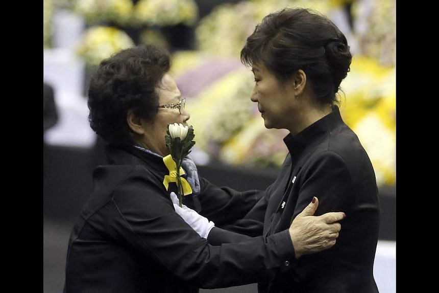 South Korean President Park Geun Hye consoling an elderly woman after paying tribute at the government's official joint memorial altar for the victims of the sunken ferry Sewol at Ansan Hwarang Park in Ansan, south of Seoul, South Korea, on April 29,
