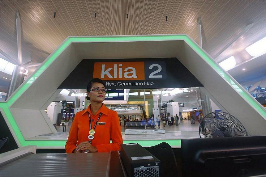 A staff stands near an information counter at Kuala Lumpur International Airport 2 (KLIA2) in Sepang on April 30, 2014. -- FILE PHOTO: REUTERS