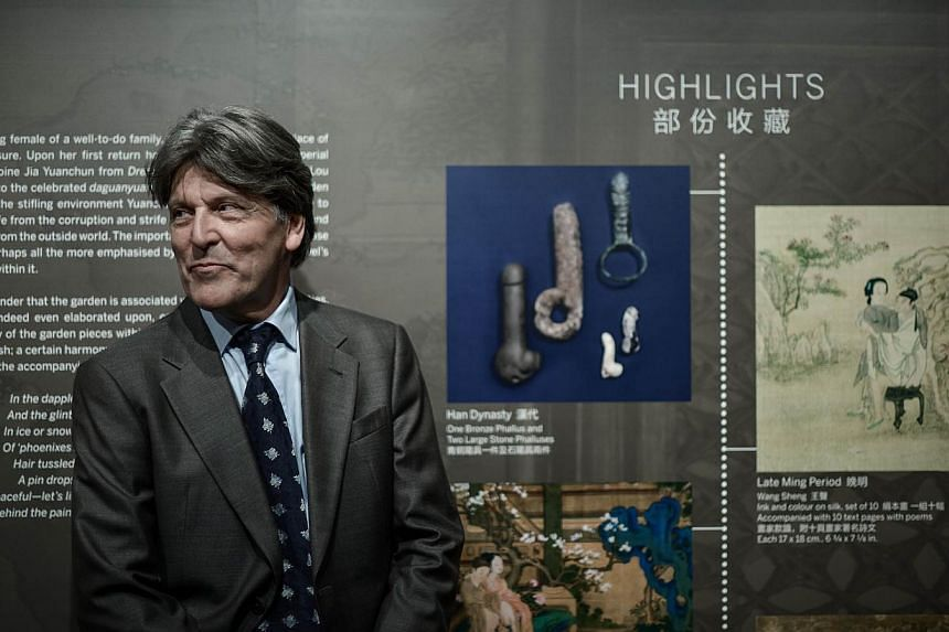 """Dutch collector Ferdinand Bertholet looks on during the preview of the exhibition """"Gardens of Pleasure: Sex in Ancient China"""" in Hong Kong on April 15, 2014. Explicit works of Chinese erotic art went on display, as Mr Bertholet aims to bring back the"""