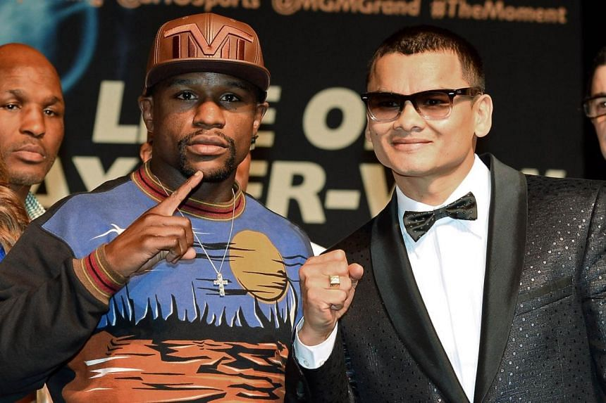 WBC welterweight champion Floyd Mayweather Jr. (left) and WBA champion Marcos Maidana pose during a news conference at the MGM Grand Hotel/Casino on April 30, 2014, in Las Vegas, Nevada. Pound-for-pound king Floyd Mayweather has what he considers the