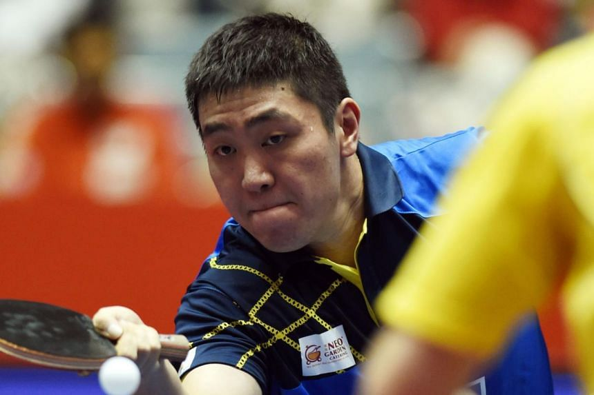 Gao Ning of Singapore hits a return against Kristian Karlsson of Sweden during their men's singles quarter-final match at the World Team Table Tennis Championships in Tokyo on May 2, 2014. The win helped Singapore's men's team beat No. 12 seeds Swede
