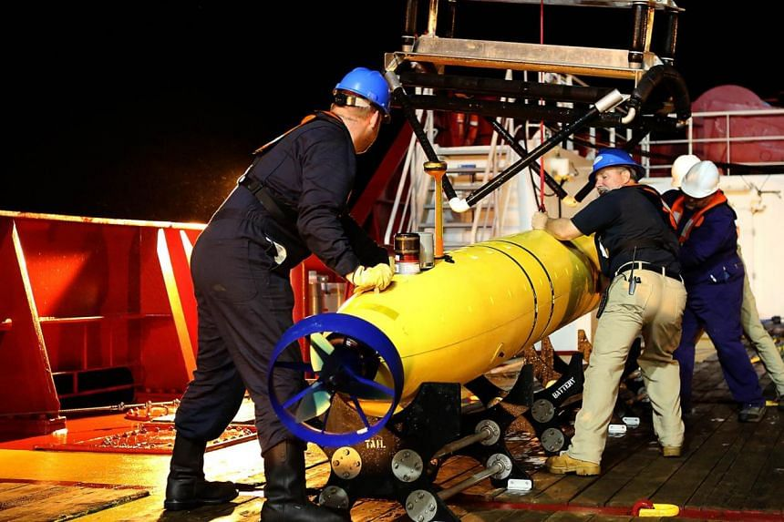 The Phoenix Autonomous Underwater Vehicle (AUV) Artemis being recovered onto Australian Defence Vessel Ocean Shield after completing a mission in the search for the missing Malaysia Airlines Flight MH370 in the southern Indian Ocean, on April 24, 201
