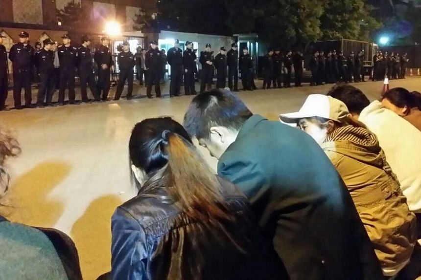 Family members protesting outside the Malaysia embassy in Beijing, on April 25, 2014. Relatives of Chinese passengers aboard missing Malaysia Airlines flight 370 expressed anger on Friday, May 2, 2014, after being told they must suddenly leave their