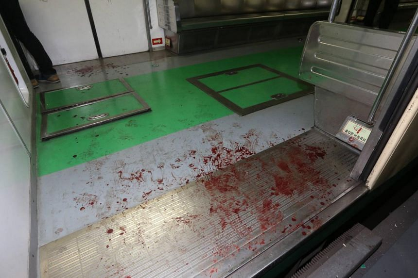 Blood marks are seen on the floor of a damaged subway train at a subway station in Seoul on May 2, 2014. -- PHOTO: REUTERS