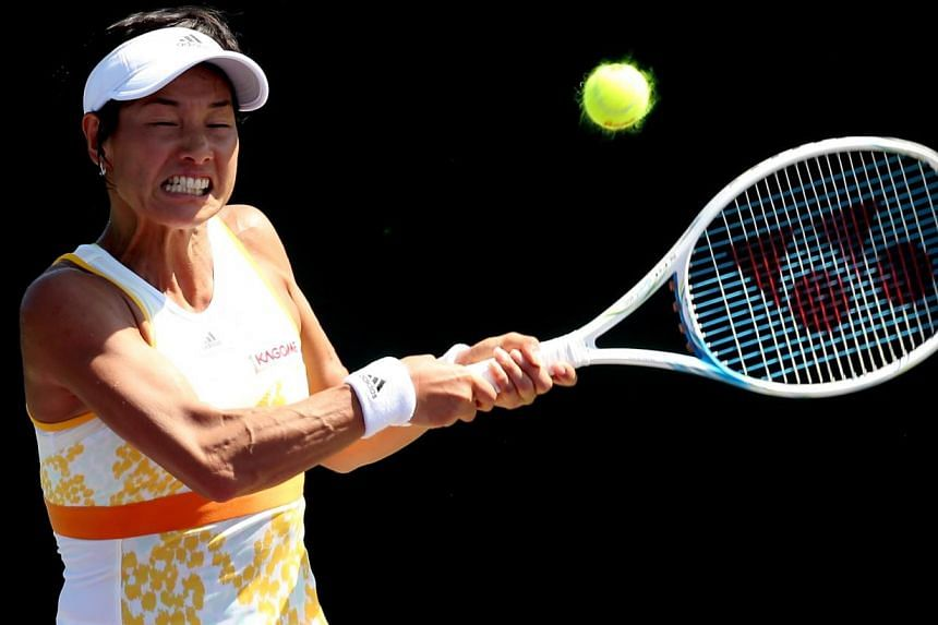 Kimiko Date-Krumm of Japan returns a shot to Donna Vekic of Croatia during the Sony Open at the Crandon Park Tennis Centre, on March 19, 2014, in Key Biscayne, Florida. Date-Krumm has no plans to quit tennis at the ripe old age of 43 but told AFP she