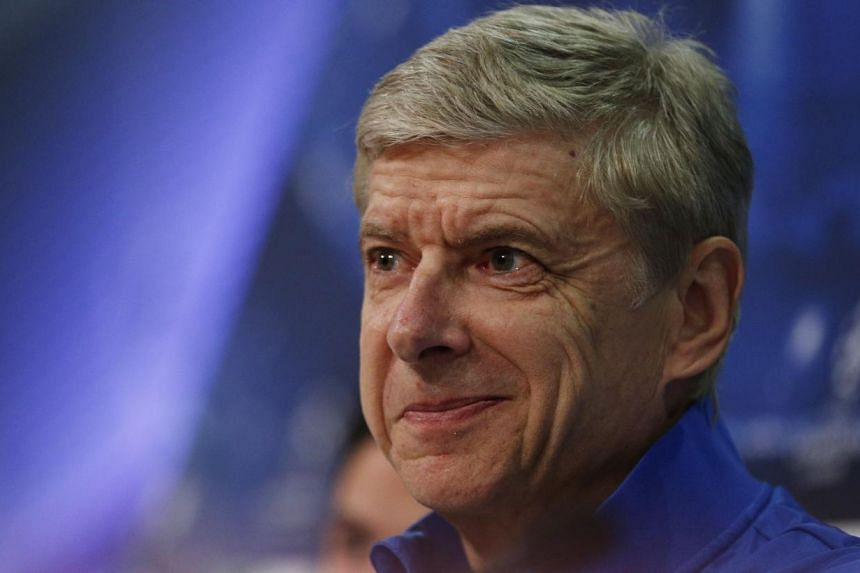 Arsenal could secure a top-four finish and the chance of Champions League football for the 17th successive season on Saturday without kicking a ball, but coach Arsene Wenger was left ruing what might have been on Friday. -- FILE PHOTO: AFP