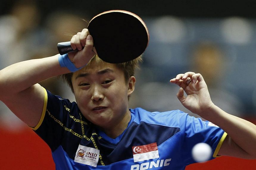 Singapore's Feng Tianwei hits a return to France's Carole Grundisch during the World Team Table Tennis Championships in Tokyo May 1, 2014.The national women's table tennis team took out Romania 3-1 in the quarter-finals of the World Team Table