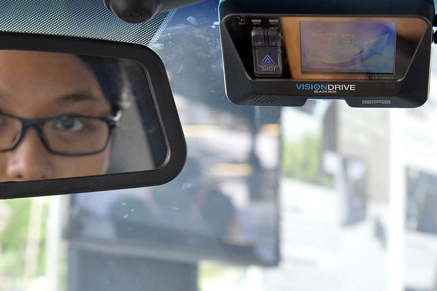SPF is introducing the Fast Response Car In-Vehicle Video Recording System (FRC-IVVRS) . It will be deployed in selected FRCs by June 2014. -- ST PHOTO: DESMOND FOO