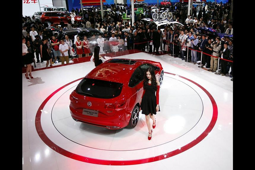 Motor shows in China, such as Auto China 2014 Beijing International Automotive Exhibition (above), are pulling ahead of older events in the region, such as the Tokyo Motor Show. -- PHOTO: AGENCE FRANCE-PRESSE
