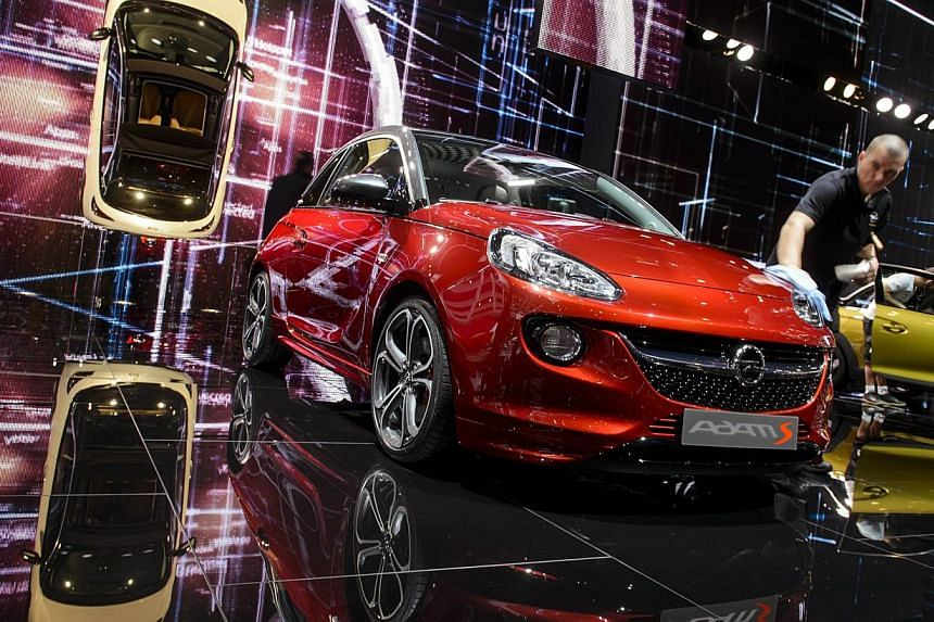The Opel Adams S model (above) on display at the booth of the German carmaker at the Geneva Motor Show in March and a Lotus Group International Eterne on display at the Paris Motor Show in 2010. -- PHOTO: AGENCE FRANCE-PRESSE
