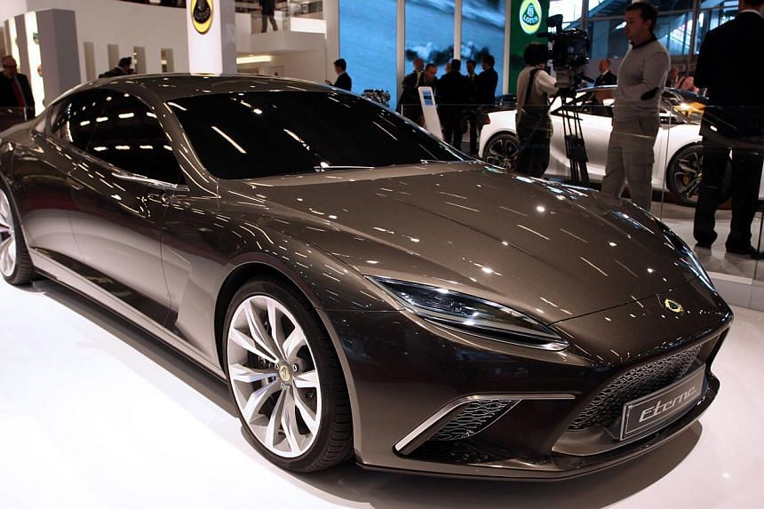 The Opel Adams S model on display at the booth of the German carmaker at the Geneva Motor Show in March and a Lotus Group International Eterne (above) on display at the Paris Motor Show in 2010. -- PHOTO: BLOOMBERG