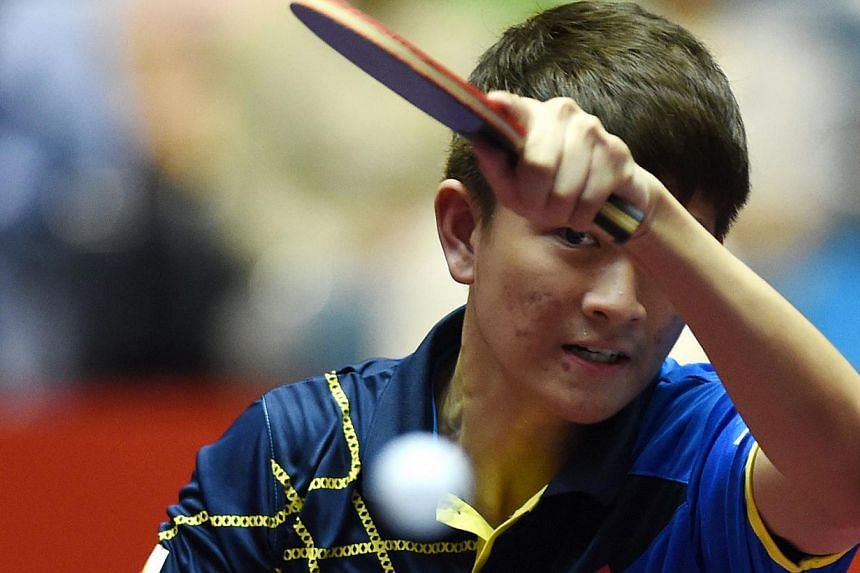 Clarence Chew of Singapore hits a return against Par Gerell of Sweden at the World Team Table Tennis Championships in Tokyo yesterday. The 18-year-old won 11-8, 11-8, 11-9 against the world No. 35.