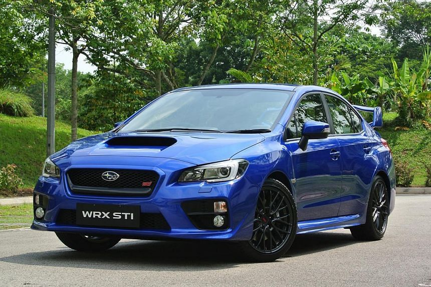 The new Subaru WRX STI's looks are distinguished by sharper headlights in front and a slightly over-the-top spoiler at the rear. -- ST PHOTO: TOH YONG CHUAN