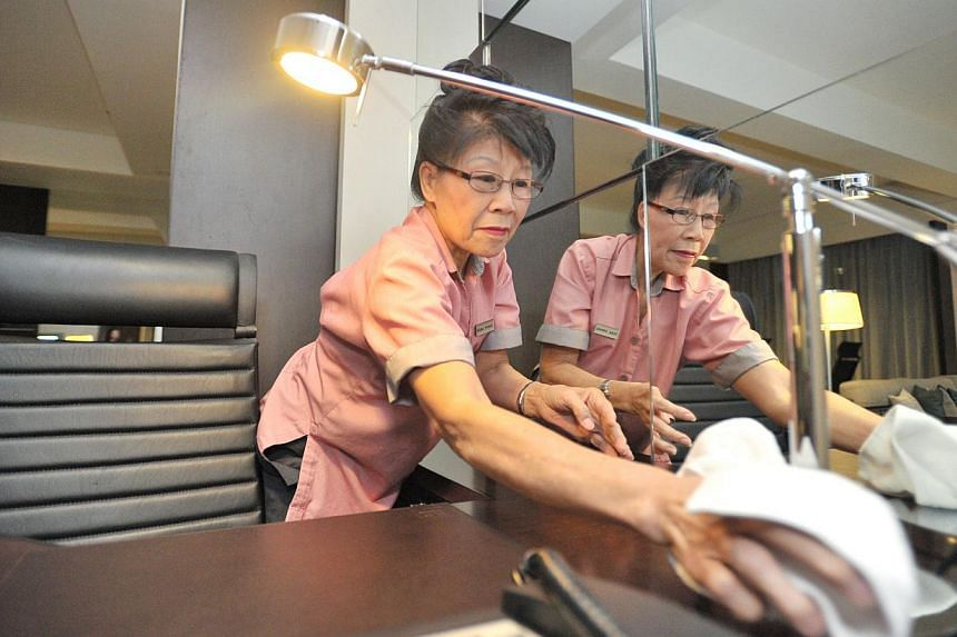 Madam Tan Kim Hing, 66, a housekeeping attendant at Royal Plaza on Scotts. More companies are keen on keeping older employees at work, especially given the tight labour market here. -- ST FILE PHOTO: LIM YAOHUI