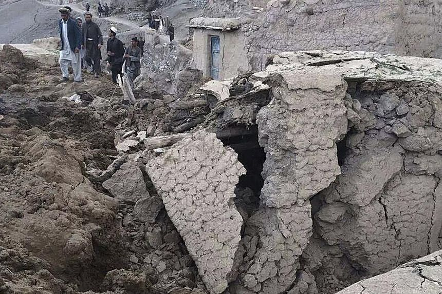 Afghan villagers gather at the site of a landslide at the Argo district in Badakhshan province, on May 2, 2014. Afghan officials gave up hope on Saturday of finding any survivors from a landslide in the remote north-east, putting the death toll at mo