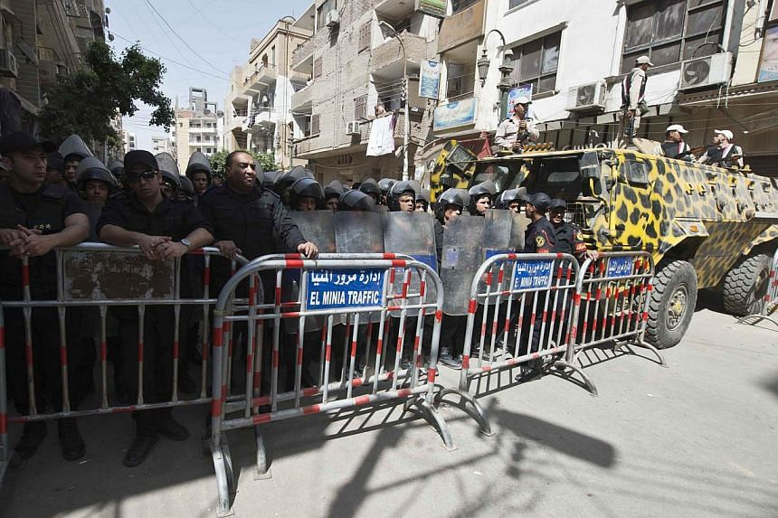 Egyptian security forces stand guard outisde the court that sentenced 682 alleged Islamists and a Muslim Brotherhood leader to death on April 28, 2014, in the southern city of Minya. An Egyptian court sentenced 102 supporters of ousted Islamist presi