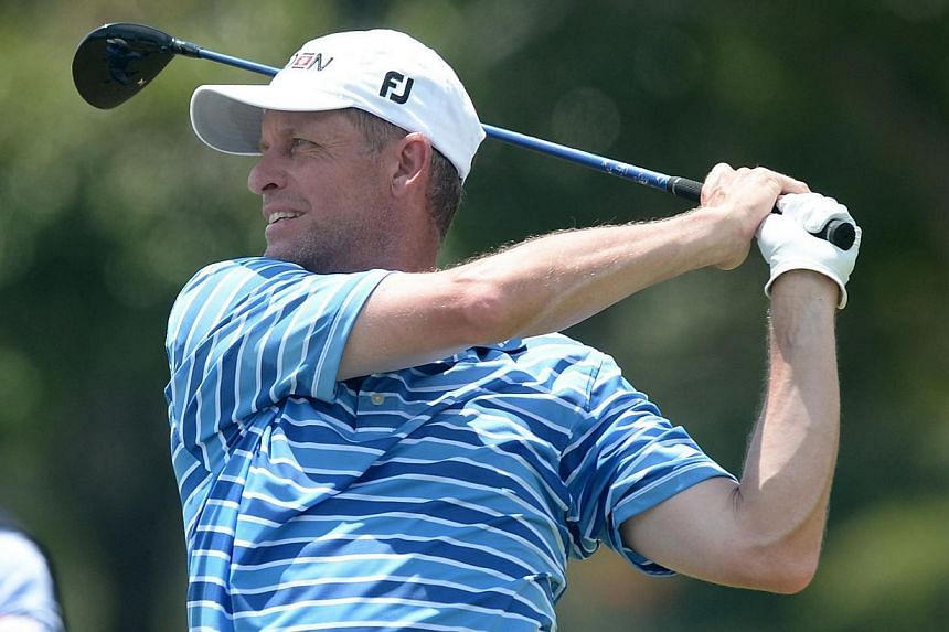 Anders Hansen of Denmark hits a tee off during round two of The Championship at Laguna National on May 2, 2014, in Singapore.Hansen showcased some spectacular putting to share the lead with Thai Panuphol Pittayarat going into the final round of