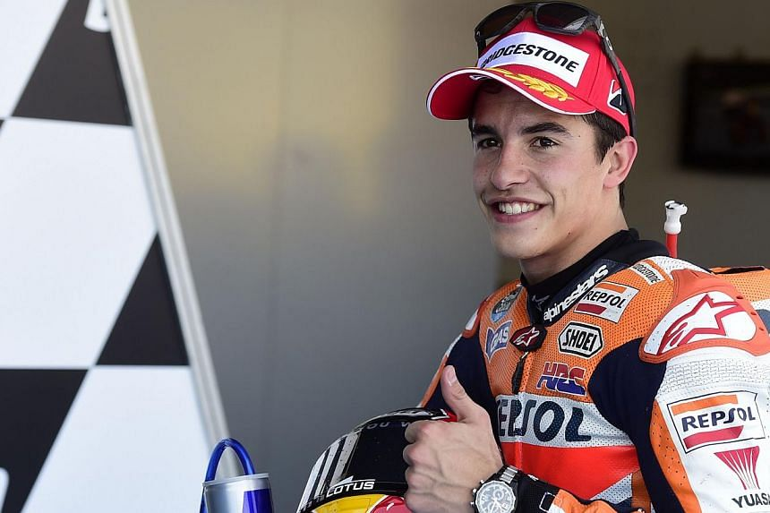 Repsol Honda Team's Spanish rider Marc Marquez gives the thumbs up after claiming pole position following the MotoGP qualifying round of the Spanish Grand Prix at the Jerez racetrack in Jerez de la Frontera on May 3, 2014. Reigning world champion Mar
