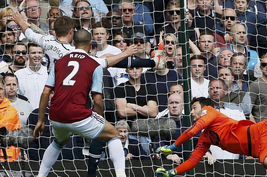 Andy Carroll of West Ham United's deflected header sails past goalkeeper Hugo Lloris of Tottenham Hotspur at Upton Park on May 3, 2014. -- PHOTO: REUTERS