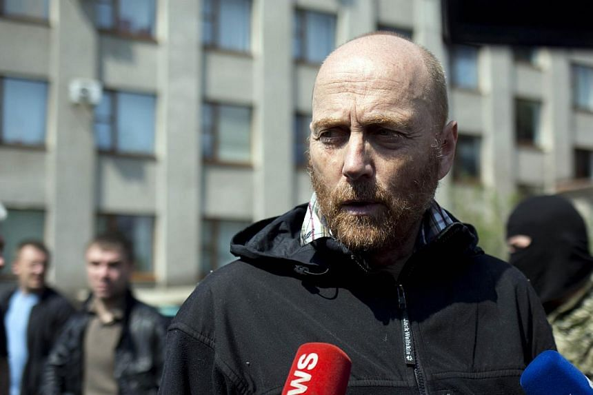 One of the freed OSCE observers, Axel Schneider, speaks to reporters in the southern Ukrainian city of Slavyansk on May 3, 2014. European military observers held captive in Slaviansk in eastern Ukraine were released on Saturday, the town's pro-Russ