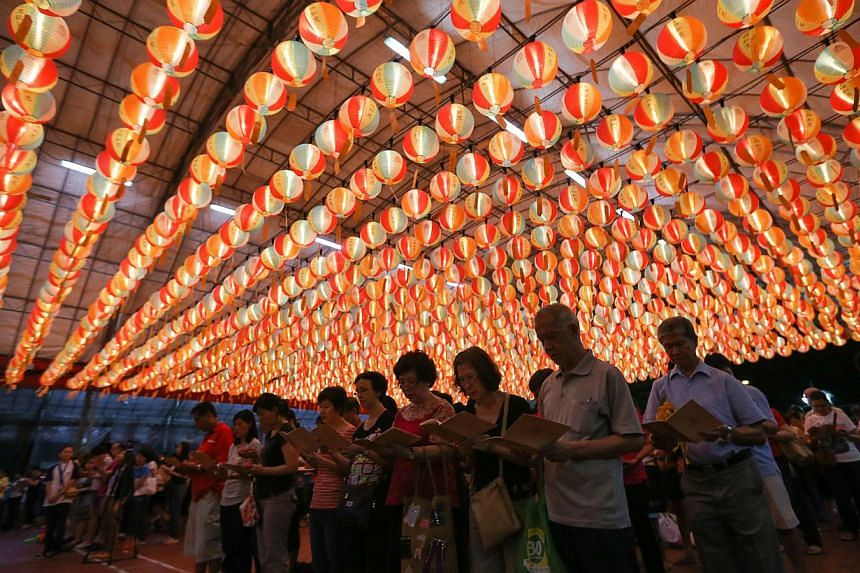 A lantern light-up ceremony at the Kong Meng San Phor Kark See Monastery in celebration of Vesak Day. About 8,000 devotees packed the Kong Meng San Phor Kark See Monastery on Saturday night for a candle-lit procession for an early Vesak Day celebrati