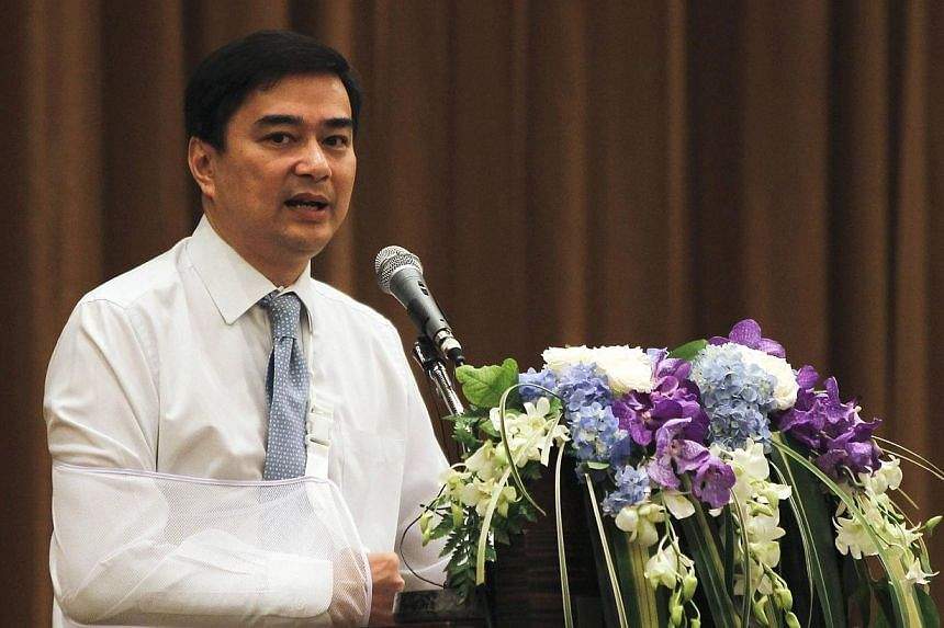 Thai opposition leader and former prime minister Abhisit Vejjajiva speaks during a news conference at a hotel in Bangkok on Saturday, May 3, 2014. -- PHOTO: REUTERS