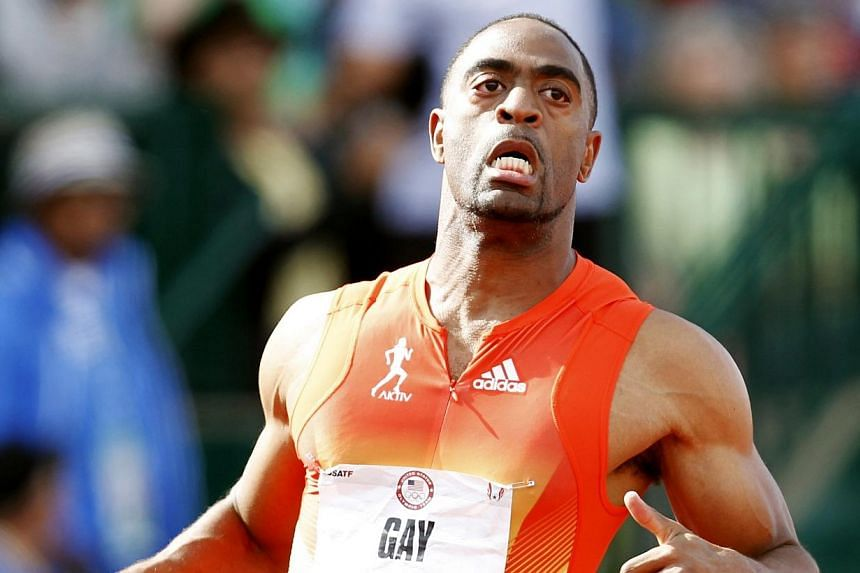 US runner Tyson Gay crosses the finish line in the men's 100m dash during the US Olympic Athletic Trials in Eugene, Oregon on June 24, 2012. Gay has received a one-year doping ban from the US Anti-Doping Association (USADA) and returned his 2012 Lond