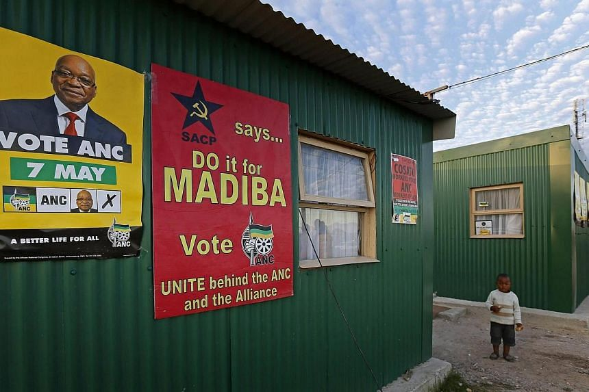 Election posters are seen on a shack in Cape Town's Khayelitsha township onMay 2, 2014, as South Africa gears up for elections. Despite increasing violent protests by throngs of poor youth demanding better government services, the ruling ANC is