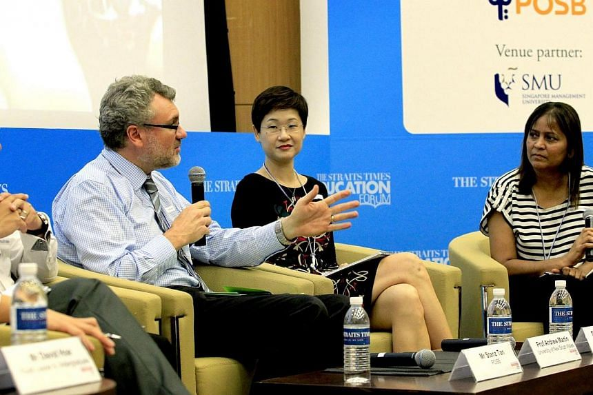 (From left) Professor Andrew Martin from University of New South Wales and Monfort Junior School principal Genevieve Chye taking part in a panel discussion moderated by Ms Sandra Davie, The Straits Times' senior education correspondent. Parents posed