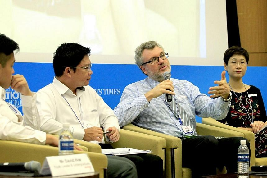 (From left) Final-year National University of Singapore undergraduate David Hoe, POSB expert Stanz Tan, Professor Andrew Martin from University of New South Wales, and Monfort Junior School principal Genevieve Chye taking part in a panel discussion d