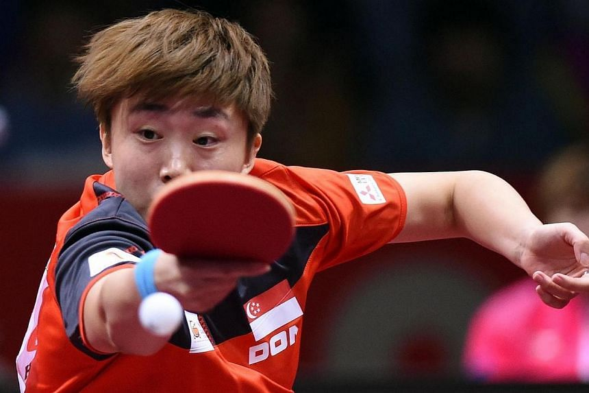 Feng Tianwei of Singapore returns the ball to Li Xiaoxia of China during their women's singles semi-final match of the 2014 World Team Table Tennis Championships in Tokyo on May 4, 2014.Singapore's women paddlers will settle for bronze after lo
