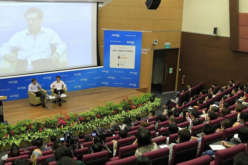 The inaugural Straits Times Education Forum, attended by Education Minister Heng Swee Keat and moderated by ST editor Warren Fernandez, at the Singapore Management University's Mochtar Riady Auditorium on May 4, 2014. -- ST PHOTO: CHEW SENG KIM