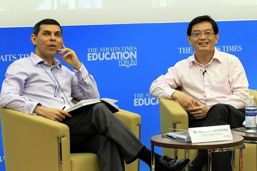 The inaugural Straits Times Education Forum, attended by Education Minister Heng Swee Keat (right) and moderated by ST editor Warren Fernandez, at the Singapore Management University's Mochtar Riady Auditorium on May 4, 2014. -- ST PHOTO: CHEW SENG K