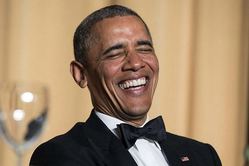 US President Barack Obama laughs at a joke during the White House Correspondents' Association Dinner in Washington on May 3, 2014. -- PHOTO: REUTERS