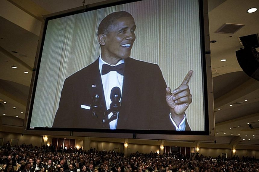 US President Barack Obama is shown on a screen as he speaks during the White House Correspondents' Association Dinner in Washington on May 3, 2014. -- PHOTO: REUTERS