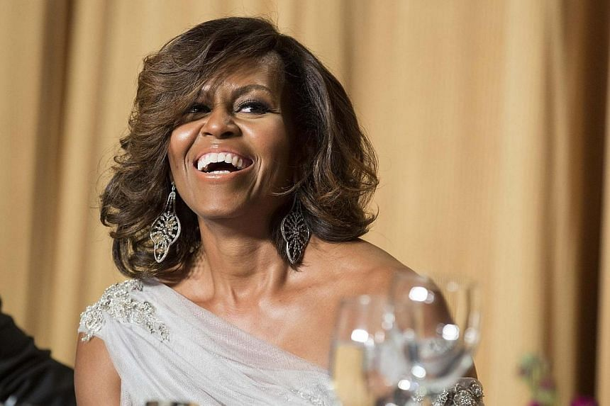 US First Lady Michelle Obama laughs during the White House Correspondents' Association Dinner in Washington on May 3, 2014. -- PHOTO: REUTERS