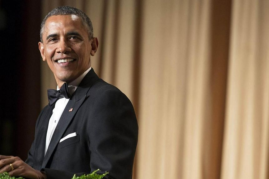 US President Barack Obama speaks during the White House Correspondents' Association Dinner in Washington on May 3, 2014. -- PHOTO: REUTERS