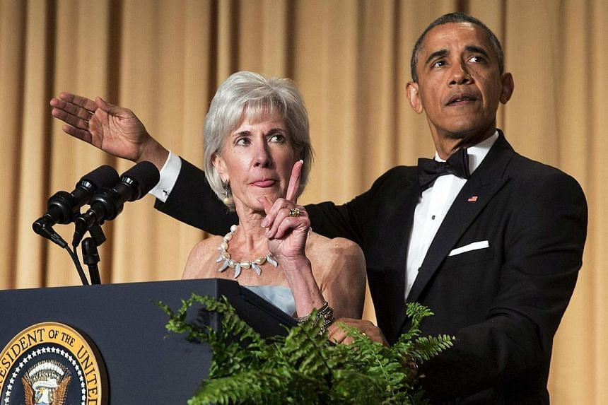 U.S. President Barack Obama and Health and Human Services Secretary Kathleen Sebelius gesture as they take part in a joke during the White House Correspondents' Association Dinner in Washington on May 3, 2014. -- PHOTO: REUTERS