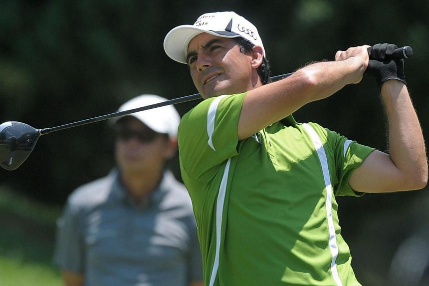 Felipe Aguilar of Chile hits a shot during the final round of the Championship golf tournament at Laguna National in Singapore on May 4, 2014.Chile's Felipe Aguilar fired a sensational final round of 10-under 62 to win The Championship at Lagun