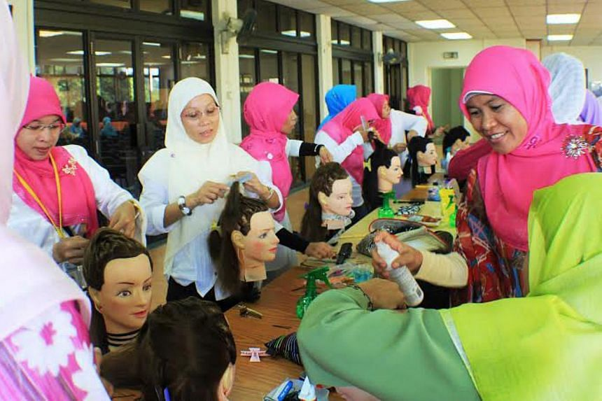 Self-improvement for foreign domestic helpers: An international culinary course at the ACMI Training Centre; a computer course and a hairdressing course (above) at the Mujahidin Mosque. -- PHOTOS: ACMI, MUJAHIDAH LEARNING CENTRE