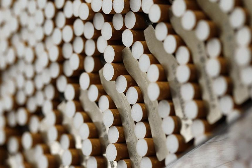 Cigarettes are seen during the manufacturing process in the British American Tobacco Cigarette Factory (BAT) in Bayreuth, southern Germany, on April 30, 2014. -- FILE PHOTO: REUTERS