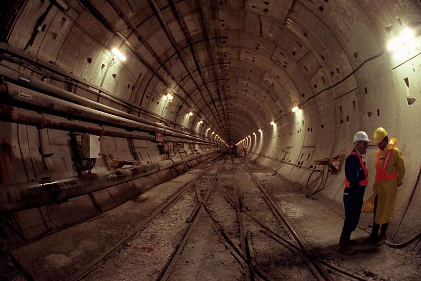 In a file picture taken on Nov 27, 1990, technicians work on the construction site of the Channel tunnel in Sangatte, northern France. -- FILE PHOTO: AFP