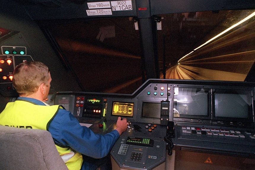 A picture taken on May 2, 1994 shows a machinist driving a trans-channel shuttle during a technical trial run in Cheriton, a suburb of Folkestone. -- FILE PHOTO: AFP