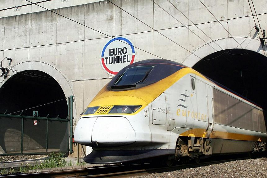 In a file picture taken on July 13, 2006 a Eurostar train emerges from the Eurotunnel, 13 in Coquelles, northern France. -- FILE PHOTO: AFP
