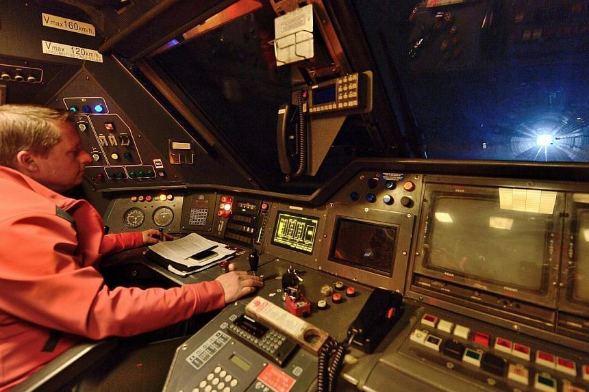 Train driver Willy Crooks, 46, drives a EuroTunnel train on April 10, 2014 between Calais and Folkestone near Coquelles, northern France. -- FILE PHOTO: AFP